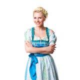 Belle femme dans un dirndl bavarois traditionnel Image stock