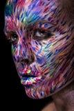 Belle femme de mode avec l'art lumineux de visage de couleur Images libres de droits