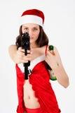 Belle femme de Santa avec l'arme à feu Photographie stock libre de droits
