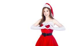 Belle femme de Santa faisant un coeur avec sa main sur le wh Images libres de droits