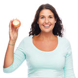 Belle femme mangeant la pomme Images stock