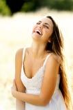 Belle femme riante Photos stock
