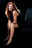 Belle femme rouge de cheveu Photo stock