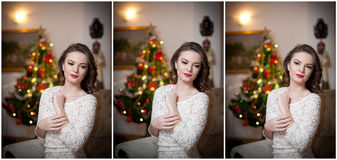 Belle femme sexy avec l'arbre de Noël à l'arrière-plan se reposant sur la chaise élégante dans le paysage confortable Portrait de Photos libres de droits