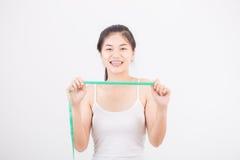 Belle femme sportive avec la mesure Image libre de droits