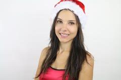 Belle femme utilisant un chapeau de Santa photos libres de droits