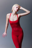 Belle fille émotive dans la robe rouge images libres de droits