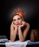 Belle fille avec du fer Photographie stock libre de droits