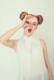 Belle fille avec la coiffure drôle Photographie stock libre de droits