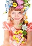 Belle fille avec le guindineau et la fleur. Photos libres de droits