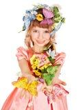 Belle fille avec le guindineau et la fleur. Photographie stock libre de droits