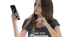 Belle fille avec le téléphone photo libre de droits