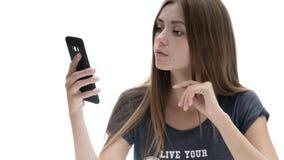 Belle fille avec le téléphone photographie stock