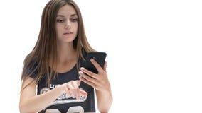 Belle fille avec le téléphone photographie stock libre de droits