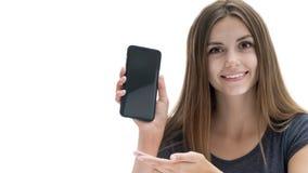 Belle fille avec le téléphone photo stock