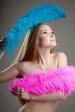 Belle fille avec les clavettes colorées Photo libre de droits