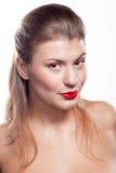 Belle fille avec les languettes rouges Images stock