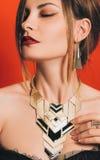 Belle fille avec un maquillage spectaculaire Photographie stock