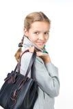 Belle fille avec un sac Photo stock