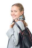 Belle fille avec un sac Photographie stock