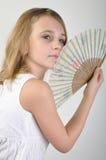 Belle fille avec un ventilateur Photo libre de droits