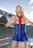 Belle fille blonde dans l'uniforme Photographie stock libre de droits
