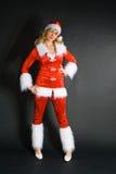 Belle fille blonde sexy rectifiée comme Santa Images stock