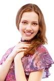 Belle fille dans des sourires bariolés de robe Images stock
