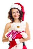 Belle fille dans des vêtements de Santa Claus avec l'ours Image stock