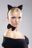 Belle fille dans l'image d'un chat Photographie stock libre de droits