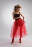 Belle fille dans la jupe rouge Photographie stock libre de droits