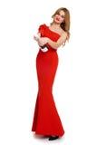 Belle fille dans la robe rouge avec le champagne d'isolement sur le fond blanc, concept de vacances d'hiver Photographie stock