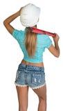Belle fille dans le casque blanc, les shorts et la chemise photographie stock libre de droits