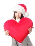 Belle fille dans le chapeau de Santa Image libre de droits