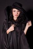 Belle fille dans le chapeau noir Image libre de droits