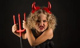 Belle fille dans le costume de diables Photos stock