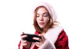 Belle fille dans le costume de Santa Claus photos libres de droits