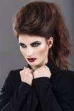 Belle fille dans le style gothique avec lumineux Photos libres de droits