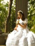 Belle fille dans sa première communion Photographie stock