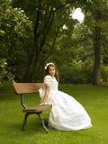 Belle fille dans sa première communion Photographie stock libre de droits