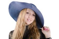 Belle fille dans un chapeau bleu Photos libres de droits