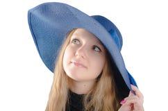 Belle fille dans un chapeau bleu Image libre de droits