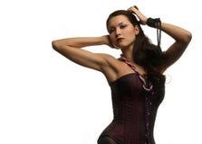 Belle fille dans un corset Photographie stock libre de droits