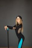 Belle fille dans un costume de sport Images stock