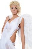 Belle fille dans un procès d'un ange blanc Image stock