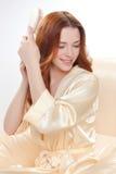 Belle fille dans une chemise beige Photo libre de droits
