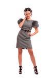 Belle fille dans une robe grise Images stock