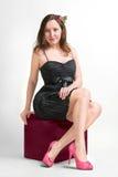 Belle fille dans une robe noire Image libre de droits