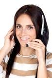 Belle fille de brunette avec l'écouteur Photographie stock libre de droits