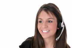 Belle fille de l'adolescence avec l'écouteur au-dessus du blanc Photos libres de droits
